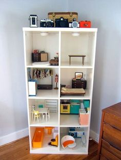 bookshelf as dollhouse- my mom made one of these for me and wallpapered and carpeted it with samples from the store.
