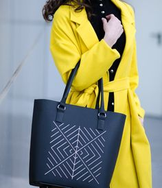 Black leather bag eith white embroidery matched with neon yellow trench. #newcollection #NEO #CHIbag