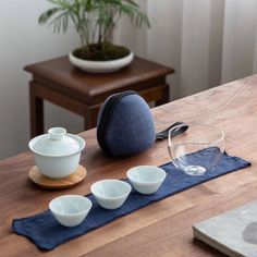 Want some tea with your afternoon picnic, but don't want to take half the kitchen with you? This travel tea set is a wonderful find. Easy to take on a quick get away or picnic, . Zen Interiors, Tea Pitcher, Tea Canisters, Glass Pitchers, Tea Accessories, Tea Ceremony, Fabric Covered, Tea Cups, Ceramics