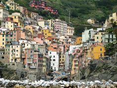 On the Ligurian coast of Italy, sit five colourful seaside villages, known as Cinque Terre. These villages make up one of the most scenic regions of Italy. Italy Travel, Italy Trip, Riomaggiore, Seaside Village, Regions Of Italy, Cinque Terre, Coast, Spaces, Adventure