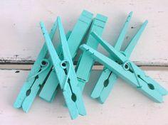 aqua colored clothespins . . .perfect clip for the art!