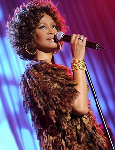 whitney houston  :(  I LOVE her voice,  and she is an Amazing actress..  when she sang the National Anthem,  I literally cried,  listened to it again this morning and cried for a whole different reason :(    Now she can be the lead singer for all the angels