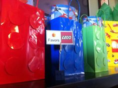 Favor bags. Made with regular bags and circle punch outs applied with a styrofoam dot to make them pop and hopefully look like Lego blocks.