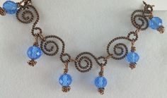 This beauty was created using just wire and beads.  The wire was in two different tones of brown and the beads a brilliant blue.