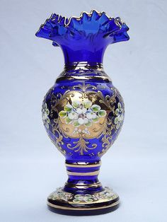 "7¾"" Bohemian raised enamel & gold blue glass vase"