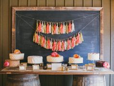 Instead of having one large, multi-tiered cake, the bride and groom opted for a buffet of cakes in a variety of flavors, including red velvet, carrot, tres leches, strawberry and more, which lent a retro, bake sale vibe to the tablescape.