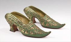 """Slippers (Mules)  Pietro Yantorny  (Italian, 1874–1936)  Date: 1914–19  Culture: French  Medium: silk, metal  Dimensions: 3 3/4 x 10 in. (9.5 x 25.4 cm)  Accession Number: 2009.300.1459a, b  Yantorny , the self-proclaimed """"most expensive shoemaker in the world"""", was utterly devoted to the art of shoemaking. This pair of mules was made for Rita de Acosta Lydig, a collector of lace and antique textiles. with Orientalist tastes. These mules are inspired by the Turkish babouche."""