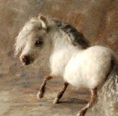 Amazing felted pony...I love this little rotund pony!