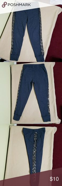 Abercrombie blue capri sweatpants with sequins Abercrombie blue capri sweatpants with sequins.  In good condition.  Length is about 31 inches.  Inseam is about 23 inches.  Waist is about 24 inches.  Made of 60% cotton and 40% polyester. Abercrombie & Fitch Pants Capris