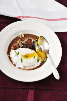 Poached Egg, Spicy Sausage and Grits with Porcini Mushroom and Wine Reduction -