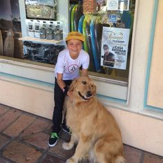 """Pin for Later: Britney Spears's Sweet Family Snaps Will Make You Love Her Even More  Jayden got cute with a dog in June 2015. Britney wrote in the caption, """"Great Malibu dogs!"""""""
