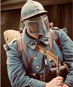 """French soldier with """"anti-sniper"""" face shield, adapted to his helment. Used when looking out from the trenches, early in the war. World War One, Second World, First World, Military Art, Military History, Ww1 Soldiers, French Army, History Photos, Historical Pictures"""