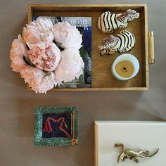 peonies, books, trays, candles, boxes