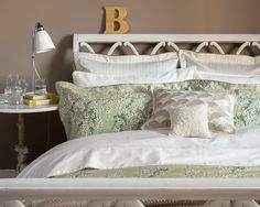 Christy Lime Blossom Made with: 100% cotton sateen. 230 thread count. Accessorized with Deco cushion and Venus cushion.