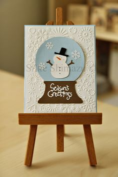 Cricut Christmas card featuring Doodlecharms snowman inside Joys of the Season snowglobe easel shot
