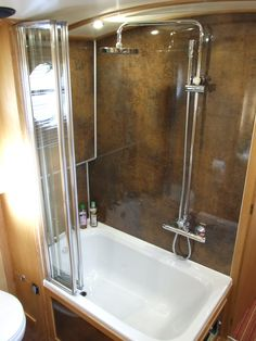 If going tiny, this to me would be one room that would have to stay relatively sizable for me. Shower Wall Urban Gloss used to line the walls out in a bathroom inside a Narrow Boat Canal Boat Interior, Catamaran Charter, Canal Barge, Narrowboat Interiors, Dutch Barge, Houseboat Living, Boat Projects, Boat Stuff, Floating House