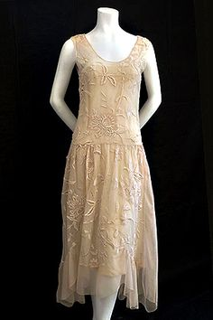 delicate embroidered 1920s dress has graceful side draperies that give an uneven hem line. [PHOTO COURTESY OF VINTAGE TEXTILE