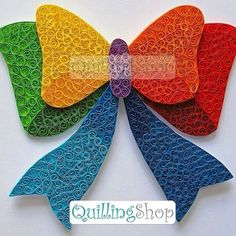 Using two tones of each colour has given depth to this beautifully quilled bow, by Quilling Shop.