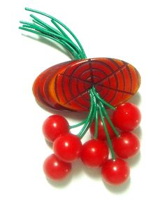 "Bakelite Cherries Pin. Bakelite cherries pin 1 3/4"" wide x 3 1/4"" long. Bright red cherries with green re-coated stems coming thru a brown carved wood log. A superb example of the ever popular Bakelite cherries pins from the 1940's. $225.00 - Free shipping in the US. Questions? PM me via FB. PayPal Only."