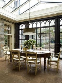 Love this conservatory inspired dining area!