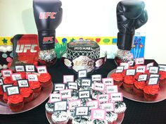 UFC cake table and cupcakes- ordered an octagon shaped cake, chocolate cupcakes, baked red velvet cupcakes. Made toppers out of construction paper and labels purchased from Etsy. Taped onto toothpicks