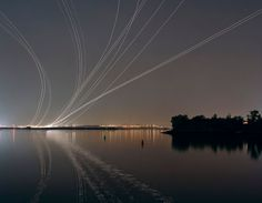 Long Exposure Airplane Trail Photos Shot at Airports Around the World