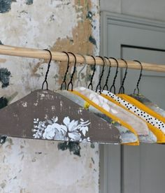 Ordinarily, I eschew wire hangers (although, not with the vehemence of Mommie Dearest), but I will make an exception in this case.  These are beautiful with their fabric (or paper?) covers.
