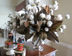 I just love natural accents.  We grew the cotton ourselves and preserved the magnolia branches with glycerine.  Took a whole season for the cotton but it was so worth it!  Cotton boll, cotton centerpiece, southern tradition, fresh farmhouse