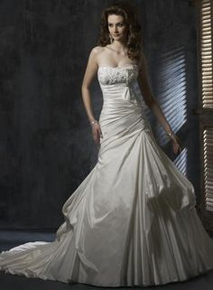 Brand new sample Maggie Sottero Riviera wedding dress has figure flattering ruched waist and pick ups in the skirt.