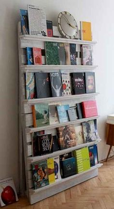 This would be neat to create a community book shelf. Basically people can bring books to donate & while you are there you can read. It's as simple as installing shelving like this (just a few shelves) on the wall, and I would lean the books up so the titles could be viewed. It would not take up a lot of space and people would probably love it (I would!)