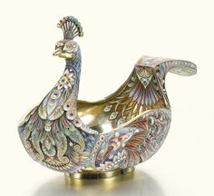 A silver-gilt and cloisonné enamel peacock-form kovsh, Ovchinnikov, Moscow, dated 1915