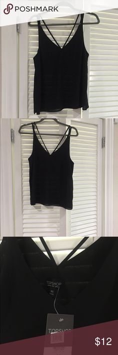 Nordstrom Topshop Tank Top Super cute basic black tank with a double strap in the back to add a little detail in the back. Partially double lines through the chest area so it's not see through 😊. Topshop Tops Tank Tops