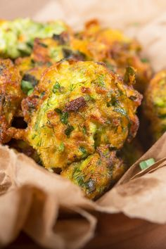 Recipe including course(s): Side; and ingredients: baking mix, black pepper, egg, garlic, oil, onion, salt, zucchini