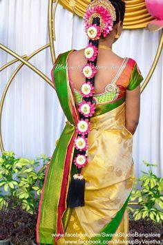 Traditional Southern Indian bride's bridal braid hair. Hairstyle by Vejetha for Swank Studio. Silk Saree. Sari Blouse Design. Hair Accessories. Silk Kanjeevaram sari. Braid with fresh flowers. Tamil bride. Telugu bride. Kannada bride. Hindu bride. Malayalee bride. Find us at https://www.facebook.com/SwankStudioBangalore
