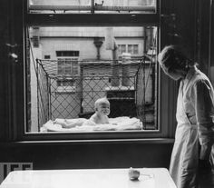 """Baby cage, 1937. A nanny supervising a baby suspended in a wire cage attached to the outside of a high tenement block window. """"Built in 1937 and distributed in London to members of the Chelsea Baby Club, the baby cage was meant for women with children but without a backyard, garden or terrace for them to play in or on."""" Photo: Reg Speller/Getty Images Jun 23, 1937"""""""
