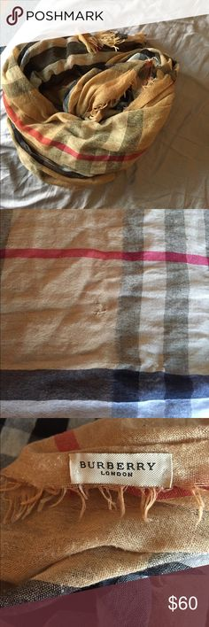 """Burberry scarf Gauzy wool/silk blend. Very soft. Also very large- approx 82"""" long and approx 26"""" wide. PLEASE NOTE : due to its delicate nature, it has some snags, and repairs. I pictured the one that caught my eye. I bought this secondhand and have not worn it- just too big for me. You will be getting this scarf third hand and it is not pristine. The snags never bothered me because frankly, the scarf is so large, they're very hard to notice. It is AUTHENTIC. Burberry Accessories Scarves…"""
