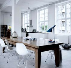 I like this kitchen/ dining.it's missing a couch. Love a couch in the kitchen area.