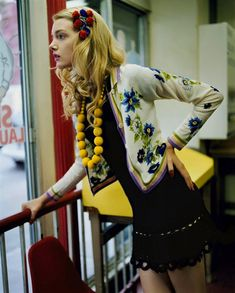 like the chunky fun jewelry, yellow and hippy-ish embroidered sweater paired with smart little preppy dress