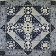 Original design by Mary Deeney: Sampler using the new Quilt Minnesota fabric. It's called Sno- Daze.
