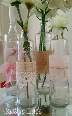 Decorate glass bottles with pretty lace and fabrics to create this shabby chic feel.