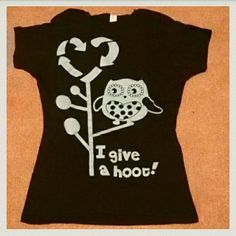 "Sale I Give A Hoot! Show you care about the environment with this ""I give a hoot!"" Tee. Black T-shirt with light blue owl and design on front. When I purchased a large part of the sale went to a charitable organization. This item is new and never worn. Comes in its original bag - I did remove it in order to snap this photo. It says it is a size large but it is very fitted and I would recommend this shirt for a size medium. Tops"