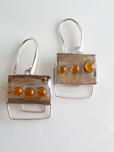 Mediterranean style earrings. The gems I cut from gray glass, have a thin gold decoration brush, the orange balls I got them with tiny round glass
