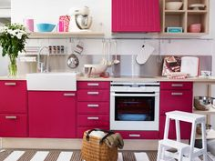 Magenta cabinets are a bold choice, but the effect is bright and cheerful. #home #office http://www.ivillage.com/home-decorating-ideas-pink/7-a-527745#