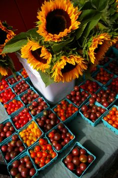 sunflowers and tomatoes, Farmers Market (no location given)..Cant wait to have fresh produce from the Garden!