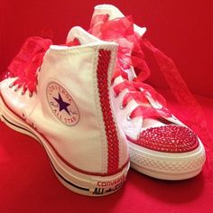 Bedazzled Hightop Converse ---Message me for different prices! --These particular pair I have done are white high-tops, women size nine. They have red ribbon in them, but I will also supply the original laces. The Rhinestones being used are also red. ---I can also customize any other colors or sizes you may need. If you have a previous owned pair already you may send them to me and I can bedazzle those. For a different customized pair message me and I can set up a new listing. Converse Shoes