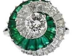 Cartier diamond, emerald, and platinum ring