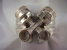 Buy Hotrod Rocks Mens Crossed Piston Ring, Size 9 at UnbeatableSale Unique Mens Rings, Unusual Rings, Rings For Men, Mens Crosses, Piston Ring, Bridesmaid Bracelet, Custom Jewelry, Men's Jewelry, Silver Jewelry