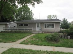 409 Grant St, Mauston, WI 53948  Seriously good deal - foreclosure but house is in good shape.  Huge open kitchen/LR Gas FP 2 car garage wrap around deck