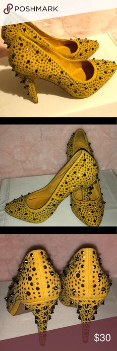 "ALDO Women's Suede Spikes Heels, Size 7/37.5 Pre-owned women's ALDO spikes suede heels in size 7/37.5 Great condition, only worn once.   Heel height: 4"" stiletto heel  Color: Sunflower/ Deep gold yellow   There are a couple of stained (possible coffee) on the inside of both sides. It can be cleaned..  The outside is in mint condition.  Please check out all the photos and let me know if you have additional questions. Aldo Shoes Heels"