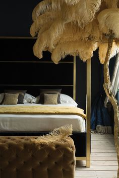 The Hoxton brushed brass Four Poster bed from And So To Bed London upholstered…